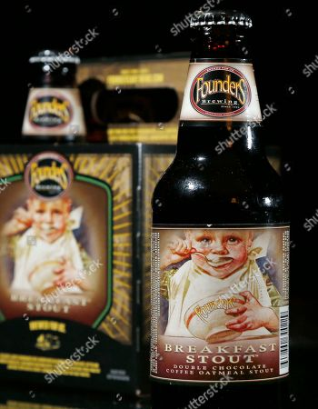 Bottles of founders Brewing Breakfast Stout are displayed in North Andover, Mass. New Hampshire Gov. Maggie Hassan, vetoed a measure that would have allowed some images of minors to grace alcoholic beverage labels in the state as long as they didn't encourage young people to drink. State Rep. Keith Murphy, who runs a popular tavern, sponsored the bill because he wanted to be able to buy Breakfast Stout, crafted by Founders Brewery Co. in Grand Rapids, Mich