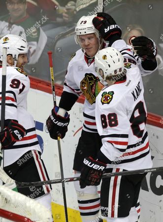 Bryan Bickell, Brad Richards, Patrick Kane Chicago Blackhawks' Bryan Bickell, center, is congratulated by teammates Brad Richards, left, and Patrick Kane after scoring against Minnesota Wild goalie Niklas Backstrom in the third period of an NHL hockey game, in St. Paul, Minn. Bickell also scored an empty-net goal in the third and Kane scored in the first period. The Blackhawks won 4-2