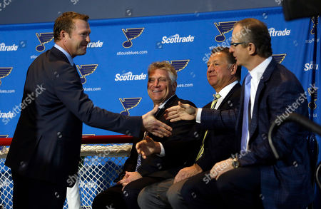 Martin Brodeur, Brett Hull, Bernie Federko, Al MacInnis St. Louis Blues' Martin Brodeur, left, shakes hands with former Blues defenseman Al MacInnis, right, as Brett Hull and Bernie Federko, second from right, watch after Brodeur announced his retirement from the NHL, in St. Louis. Brodeur finished his career with St. Louis after 21 seasons as goaltender with New Jersey. He will remain with the Blues as a senior adviser to general manager Doug Armstrong