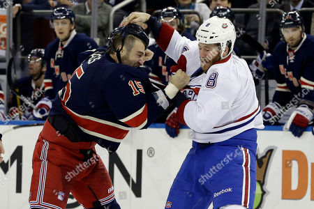 Tanner Glass, Brandon Prust New York Rangers left wing Tanner Glass (15) and Montreal Canadiens right wing Brandon Prust (8) fight during the first period of the NHL hockey game at Madison Square Garden in New York