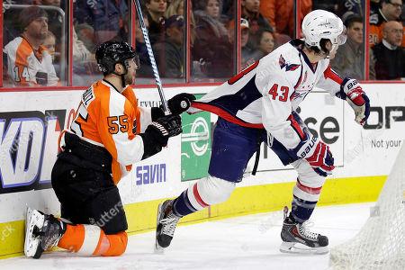 Nick Schultz, Tom Wilson Philadelphia Flyers' Nick Schultz (55) hangs onto Washington Capitals' Tom Wilson (43) during the third period of an NHL hockey game, in Philadelphia. Philadelphia won 3-2 in overtime