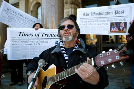 Terry Moore Terry Moore, of Verona, leads a group as they sing protest songs outside the State House before Gov. Chris Christie delivers his State of The State address, in Trenton, N.J. Environmental, education and labor activists along with the heckler whom Gov. Chris Christie told to sit down and shut up braved sub-freezing weather to criticize his management of the state