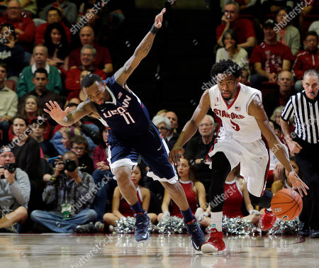 Stock Photo of Chasson Randle, Ryan Boatright Stanford guard Chasson Randle (5) dribbles past Connecticut guard Ryan Boatright during the second half of an NCAA college basketball game, in Stanford, Calif. Stanford won 72-59