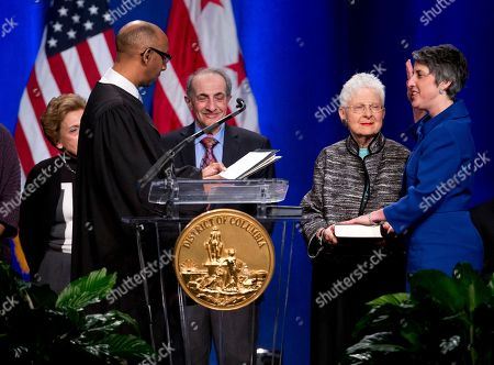 Stock Photo of Noel Johnson, Elissa Silverman Elissa Silverman, right, is sworn in as At-Large Councilmember by Noel Johnson, Magistrate Judge, Superior Court of the District of Columbia, second from left, during the 2015 District of Columbia Inauguration ceremony at the Convention Center in Washington