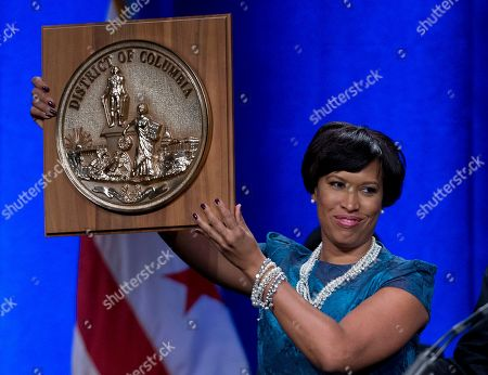 Muriel Bowser Mayor Muriel Bowser holds the seal of the District of Columbia after accepting it from former Mayor Vincent Gray during the District of Columbia Mayoral Inauguration ceremony at the Convention Center in Washington