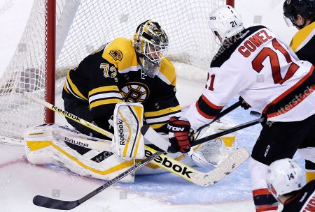 Niklas Svedberg, Scott Gomez Boston Bruins goalie Niklas Svedberg (72) makes the save as New Jersey Devils center Scott Gomez (21) looks for the rebound during the first period of an NHL hockey game in Boston