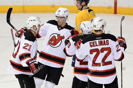 Steve Bernier, Scott Gomez, Eric Gelinas New Jersey Devils right wing Steve Bernier, center, celebrates with Scott Gomez (21) and Eric Gelinas (22) after Bernier scored a goal in the second period of an NHL hockey game against the Nashville Predators, in Nashville, Tenn