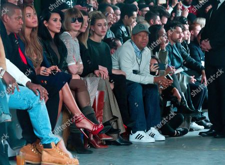 Kanye West Adidas Fall 2015 Jay-Z, from left, Beyonce, Kim Kardashian West, Anna Wintour and Russell Simmons, fourth from right, attend fashion show from Kanye West Adidas Fall 2015 collection, during Fashion Week, in New York