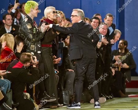 Tommy Hilfiger Fall 2015 Fashion designer Tommy Hilfiger, center, greets his son Richard and singer Rita Ora after showing his Fall 2015 collection during Fashion Week, in New York