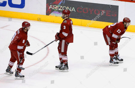Sam Gagner, Brandon McMillan, Keith Yandle Arizona Coyotes' Sam Gagner (9), Keith Yandle (3) and Brandon McMillan (22) skate off the ice after an NHL hockey game against the Calgary Flames, in Glendale, Ariz. The Flames defeated the Coyotes 4-1