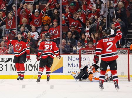 Jaromir Jagr, Scott Gomez, Marek Zidlicky, Ray Emery New Jersey Devils' Jaromir Jagr, left, of the Czech Republic, Scott Gomez (21) and Marek Zidlicky (2), of the Czech Republic, celebrate after Jagr scored a goal on Philadelphia Flyers goalie Ray Emery (29) during the first period of an NHL hockey game, in Newark, N.J