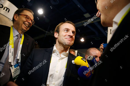 Emmanuel Macron, Henri Seydoux, Louis Schweitzer French finance minister Emmanuel Macron, center, tours the Parrot booth with Parrot CEO and founder Henri Seydoux, right, and Louis Schweitzer, at the International CES in Las Vegas