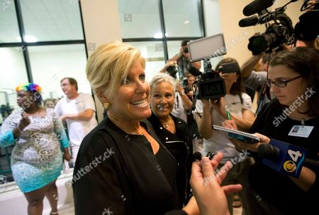 Stock Picture of Suze Orman Suze Orman and her spouse Kathy Travis talk to the media before a group wedding in Delray Beach, Fla. She came to the ceremony to support friends who were getting married. Florida's ban on same-sex marriage ended statewide at the stroke of midnight Monday, and court clerks in some Florida counties wasted no time, issuing marriage licenses overnight to same-sex couples. But they still were beaten to the punch by a Miami judge who found no need to wait until the statewide ban expired