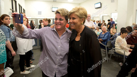 Suze orman Suze Orman poses for photos with Linda Joyce, before a group wedding in Delray Beach, Fla. Orman came to the wedding to support friends. Florida's ban on same-sex marriage ended statewide at the stroke of midnight Monday, and court clerks in some Florida counties wasted no time, issuing marriage licenses overnight to same-sex couples. But they still were beaten to the punch by a Miami judge who found no need to wait until the statewide ban expired