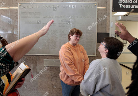 Cathy Fisher, left, and Laurie Fisher are married at the Oakland County Courthouse in Pontiac, Mich. U.S. District Judge Mark Goldsmith ruled, that Michigan must recognize hundreds of same-sex marriages performed during a brief window last year