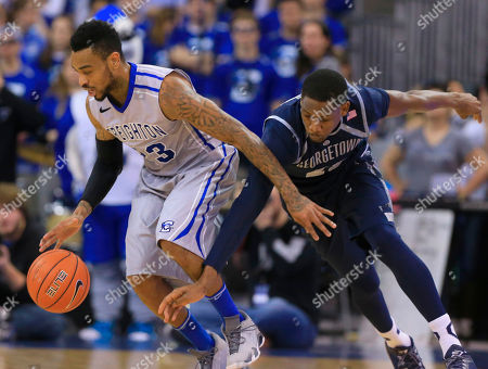 James Milliken, Aaron Bowen Georgetown's Aaron Bowen, right, tries to steal the ball from Creighton's James Milliken (23) during the first half of an NCAA college basketball game, in Omaha, Neb