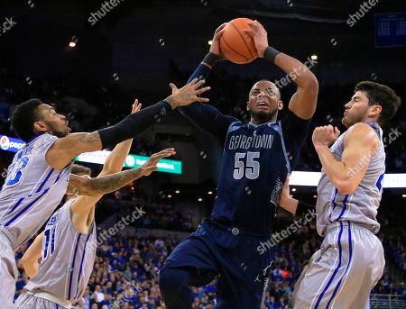 Avery Dingman, Jabril Trawick, James Milliken, Tyler Clement Georgetown's Jabril Trawick (55) drives to the basket against Creighton's James Milliken, left, Tyler Clement, back, and Avery Dingman, right, during the first half of an NCAA college basketball game, in Omaha, Neb