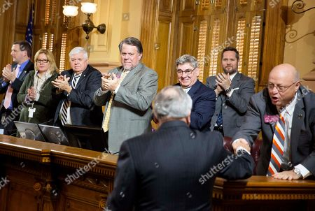 Stock Photo of Nathan Deal, Ed Rynders, Gerald Greene, Terry England, Jack Hill Georgia Gov. Nathan Deal, front, is applauded by Appropriations Committee members from right, Rep. Ed Rynders, R - Albany, Rep. Gerald Greene, R - Cuthbert, Rep. Terry England, R - Auburn, and Sen. Jack Hill, R-Reidsville, after delivering his budget address at the state Capitol, in Atlanta. Deal spoke Thursday afternoon to lawmakers charged with reviewing his $45 billion spending plan. The proposal released Friday narrows spending cuts to public schools, gives state employees a small raise and hires more child welfare employees. Deal says Georgia should use charter schools to help its prison inmates earn high school diplomas. Deal limited his comments Thursday to criminal justice, which has become a signature issue for the Republican