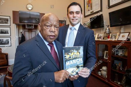 John Lewis, Andrew Aydin Rep. John Lewis, D-Ga., left, and his co-author Andrew Aydin, show the new installment of his award-winning graphic novel on civil rights and nonviolent protest, on Capitol Hill in Washington