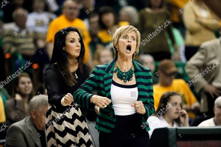 Jennifer Roberts, Kim Mulkey Baylor coordinator of basketball operations Jennifer Roberts, left, holds back head coach Kim Mulkey, right, as Mulkey reacts to a a foul charged against her team during an NCAA college basketball game against Kansas, in Waco, Texas