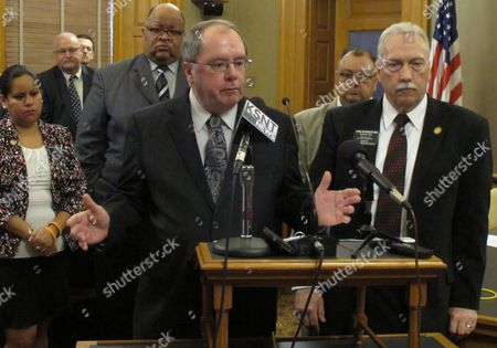 Kansas Senate Minority Leader Anthony Hensley, a Topeka Democrat, answers questions during a news conference, at the Statehouse in Topeka, Kan. Standing to his right is House Minority Leader Tom Burroughs, a Kansas City Democrat