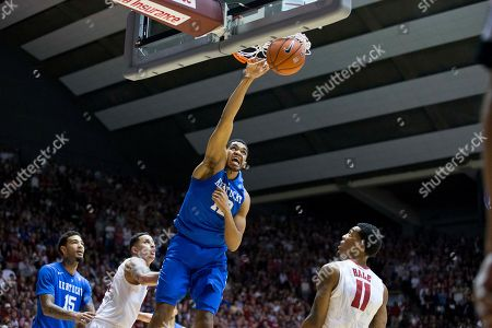 Kentucky forward Karl-Anthony Towns (12) dunks as Alabama's Michael Kessen, second from left, and Shannon Hale (10) look on during the first half of an NCAA college basketball game, in Tuscaloosa, Ala