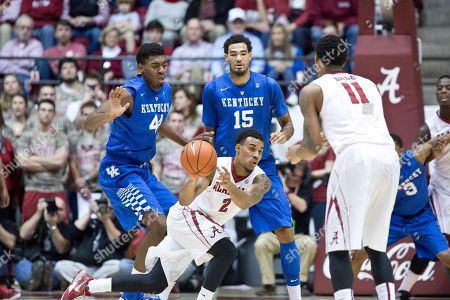 Ricky Tarrant, Shannon Hale, Dakari Johnson, Willie Cauley-Stein Alabama guard Ricky Tarrant (2) attempts a pass to teammate Shannon Hale (11) as Kentucky center Dakari Johnson (44) and forward Willie Cauley-Stein (15) defend during the second half of an NCAA college basketball game, in Tuscaloosa, Ala. Kentucky won 70-48