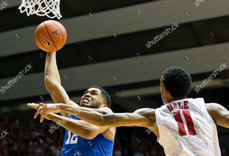 Karl-Anthony Towns Kentucky forward Karl-Anthony Towns (12) shoots as Alabama's Shannon Hale defends during the first half of an NCAA college basketball game, in Tuscaloosa, Ala