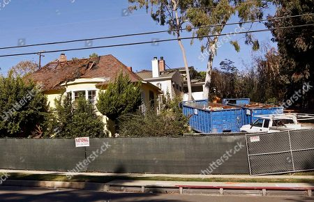 "A house being demolished that science fiction writer Ray Bradbury lived in, in the Cheviot Hills neighborhood of Los Angeles. It was the house where Bradbury wrote ""Something Wicked This Way Comes,"" and when the bulldozer came to knock it down literary scholars and preservationists were aghast. The bright yellow home with the big bay windows where the author lived and worked for 54 years wasn't the first Los Angeles landmark to be flattened of course. The statuesque Ambassador Hotel, where Robert Kennedy was assassinated in 1968, is now the site of a public-school complex"