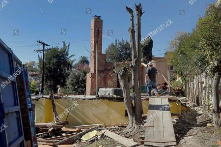 "Stock Image of This, photo, shows a house being demolished that science fiction writer Ray Bradbury lived in, in the Cheviot Hills neighborhood of Los Angeles. It was the house where Bradbury wrote ""Something Wicked This Way Comes,"" and when the bulldozer came to knock it down literary scholars and preservationists were aghast. The bright yellow home with the big bay windows where the author lived and worked for 54 years wasn't the first Los Angeles landmark to be flattened of course. The statuesque Ambassador Hotel, where Robert Kennedy was assassinated in 1968, is now the site of a public-school complex"