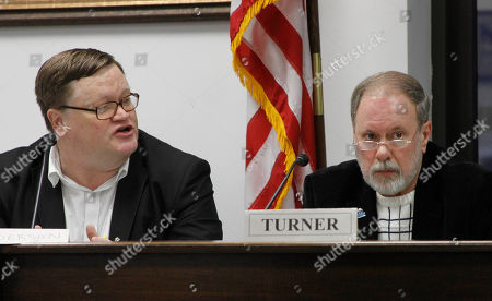 Jerry Anderson, the executive director of the Select Committee on Legislative Ethics, left, speaks during a committee hearing, in Juneau, Alaska. On the right is the committee's outgoing chairman, Gary Turner of Soldotna. The committee considered how to collect unpaid fines levied against lawmakers, and decided to investigate how other states handle the issue