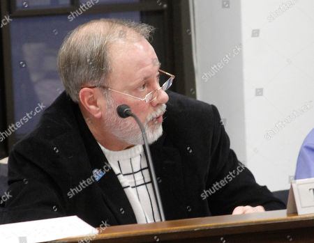 Gary Turner of Soldotna, Alaska, the outgoing chairman of the Select Committee on Legislative Ethics, listens to other members, in Juneau, Alaska. The committee considered how to collect unpaid fines levied against lawmakers, and decided to investigate how other states handle the issue