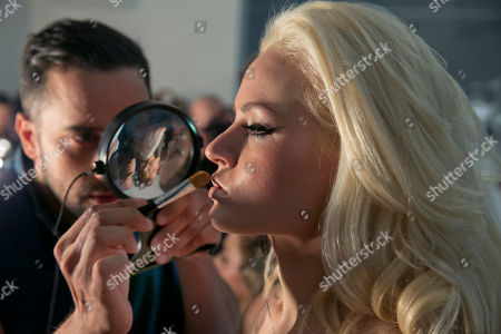 """Gia Genevieve Model Gia Genevieve has her make-up applied backstage before the 2015 CURVExpo and Invista sleepwear, loungewear and swim collections are modeled, during the 2nd annual Lingerie Fashion Night, """"Romancing the Runway,"""" in New York"""