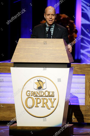 Scott Hamilton Olympic gold medal winning figure skater Scott Hamilton, a friend of the late Little Jimmy Dickens, speaks during the funeral service for Dickens in the Grand Ole Opry House, in Nashville, Tenn. Dickens died Jan. 2, 2015, at the age of 94