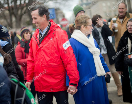 Stock Photo of Rick Santorum, Karen Garver Santorum Former Sen. Rick Santorum, R-PA., left, and his wife Karen Garver Santorums, right, talk to people during an anti-abortion rally at the annual March for Life on the National Mall in Washington, . Thousands of anti-abortion demonstrators are gathering in Washington for an annual march to protest the Supreme Court's landmark 1973 decision that declared a constitutional right to abortion