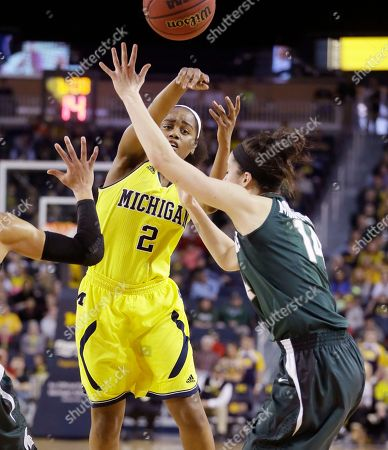 Anna Morrissey, Siera Thompson Michigan guard Siera Thompson (2) passes over Michigan State guard Anna Morrissey (14) during the first half of an NCAA college basketball game in Ann Arbor, Mich