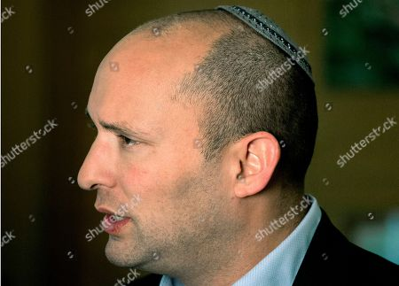 """Naftali Bennett, leader of the Jewish Home party, speaks during an interview to The Associated Press in Jerusalem. Israel's high school civics textbook, slated to be published in March, has become the latest in a string of national battles over what Israeli students learn in school. Three textbook authors have removed their names from chapters they wrote, claiming Education Ministry professionals altered their work beyond recognition. Education Minister Bennet defended the content of the book as """"excellent and professional"""