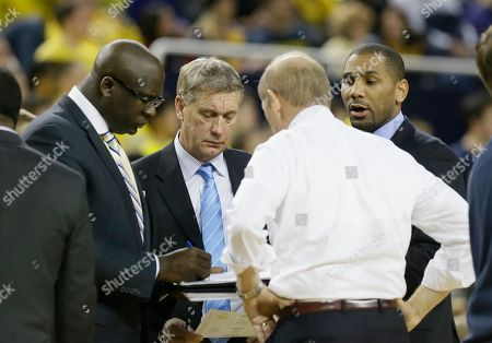 Stock Picture of John Beilein, Bacari Alexander, Jeff Meyer, LaVall Jordan Michigan assistant coaches Bacari Alexander, left, Jeff Meyer, center, and LaVall Jordan talk to head coach John Beilein during the second half of an NCAA basketball game against Minnesota, in Ann Arbor, Mich