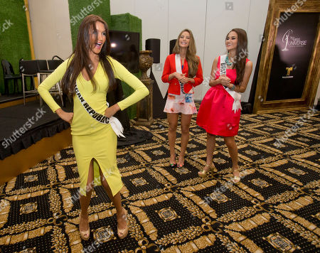 Kimberly Castillo, Ana Montufar Urrutia, Alejandra Argudo Miss Universe contestant Kimberly Castillo, of the Dominican Republic, dances as Alejandra Argudo, of Ecuador, center, and Ana Montufar Urrutia, of Guatemala, watch after a news conference for contestants from Latin America and Spain, in Doral, Fla. The Miss Universe pageant will be held on Jan. 25, in Miami