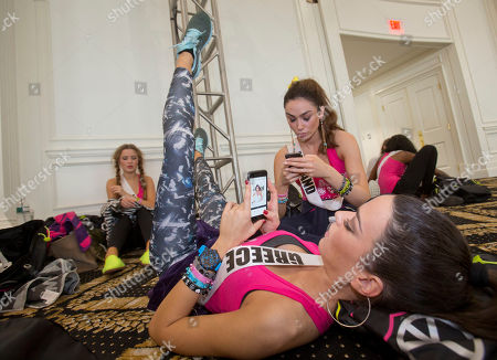 Ismini Dafopoulou, Lisa Madden, Diana Harkusha Miss Universe contestants Ismini Dafopoulou, of Greece, foreground, Lisa Madden, of Ireland, middle, and Diana Harkusha, of Ukraine, back left, rest after a Zumba class for contestants, in Doral, Fla. The Miss Universe pageant will be held Jan. 25, in Miami