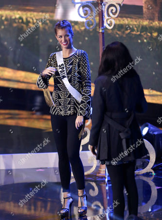 Jevon King, Desire Cordero Ferrer Miss Universe contestant Desire Cordero Ferrer, left, of Spain, chats with Jevon King of Trinidad and Tobago, during a break in rehearsals, at Florida International University in Miami. The Miss Universe pageant will be held Jan. 25, in Miami