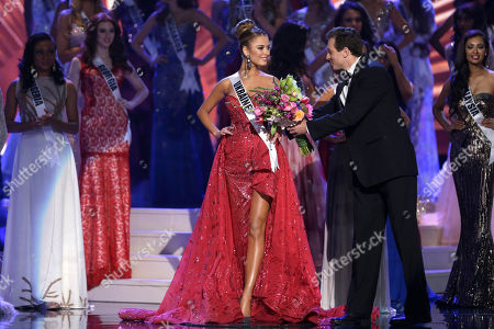 Diana Harkusha Diana Harkusha of Ukraine receives flowers after she is named second runner during the Miss Universe pageant in Miami