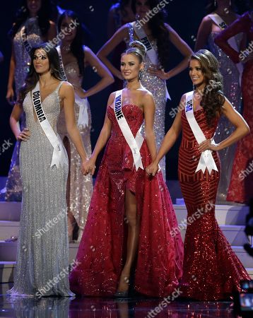Paulina Vega, Diana Harkusha, Nia Sanchez Paulina Vega of Colombia, left, Diana Harkusha of Ukraine, center, and Nia Sanchez of the U.S., hold hands as the wait for the announcement of the second runner up during the Miss Universe pageant in Miami