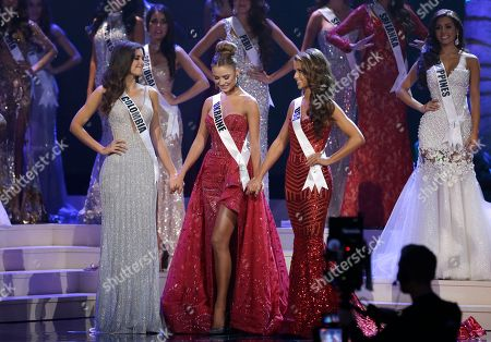 Paulina Vega, Diana Harkusha, Nia Sanchez Diana Harkusha of Ukraine, center, reacts as she is announced as second runner up while standing next to Paulina Vega of Colombia, left, and Nia Sanchez of the U.S., right, during the Miss Universe pageant in Miami