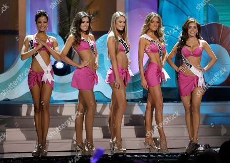 Stock Image of Kaci Fennell, Paulina Vega, Diana Harkusha, Valentina Ferrer, Mary Jean Lastimosa From left, Miss Jamaica Kaci Fennell, Miss Colombia Paulina Vega, Miss Ukraine Diana Harkusha, Miss Argentina Valentina Ferrer and Miss Philippines Mary Jean Lastimosa pose during the Miss Universe pageant in Miami