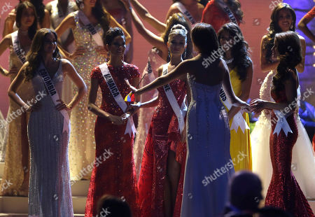Gabriela Isler, Paulina Vega Reigning Miss Universe Gabriela Isler, right foreground, talks to the final five candidates during the Miss Universe pageant in Miami, . Finalists from left: Paulina Vega of Colombia, Kaci Fennell of Jamaica, Diana Harkusha of Ukraine, Yasmin Verheijen of the Netherlands, Nia Sanchez of the U.S