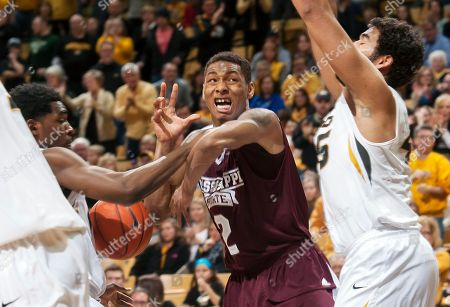Keanau Post, Namon Wright, Gavin Ware Mississippi State's Demetrius Houston, center, has the ball stripped by Missouri's Namon Wright, left, as Missouri's Keanau Post, right, defends during the second half of an NCAA college basketball game, in Columbia, Mo. Mississippi State won 77-74