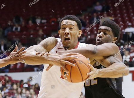 Shannon Hale, Namon Wright Alabama forward Shannon Hale tries to get past Missouri guard Namon Wright, right, during the first half of an NCAA college basketball game, in Tuscaloosa, Ala