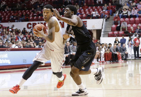 Shannon Hale, Namon Wright Alabama forward Shannon Hale (11) drives the ball toward the basket against Missouri guard Namon Wright (12) during the first half of an NCAA college basketball game, in Tuscaloosa, Ala