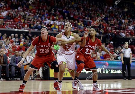 Brionna Jones, Emily Cady, Brandi Jeffery Maryland center Brionna Jones, center, tries to get past Nebraska forward Emily Cady, left, and guard Brandi Jeffery during a free throw attempt in the second half of an NCAA college basketball game, in College Park, Md